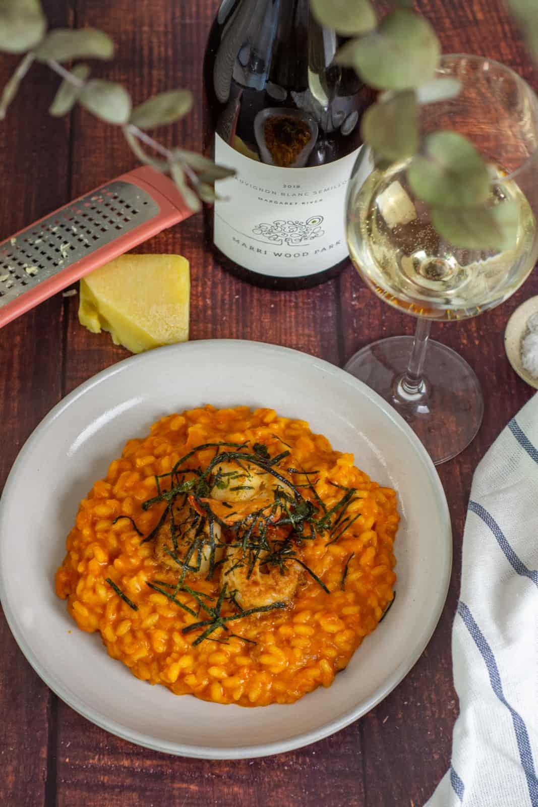 prawn risotto in a white bowl, parmesan cheese and marri wood park white wine