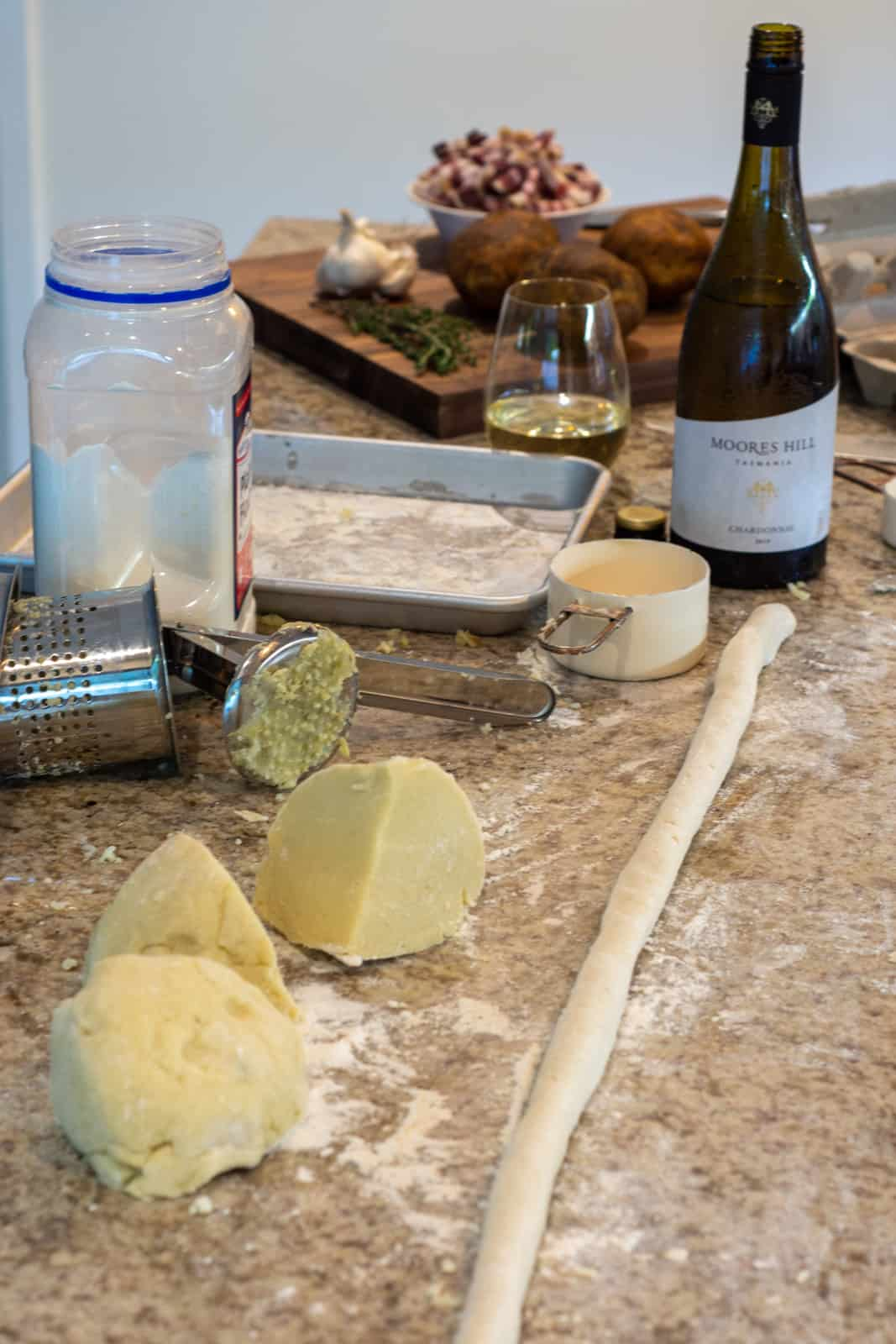 gnocchi being rolled on a kitchen worktop