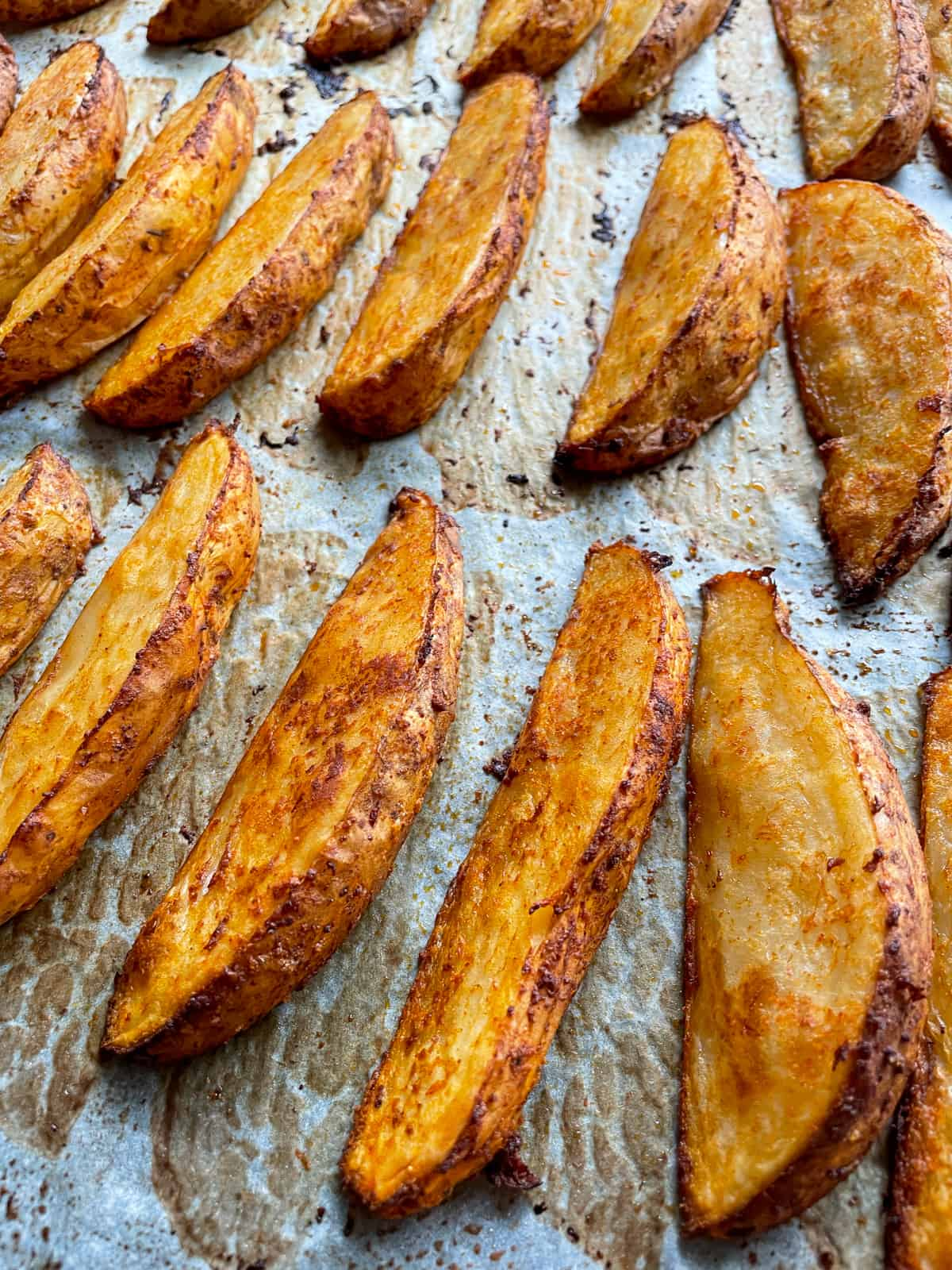 spicy potato wedges on a tray