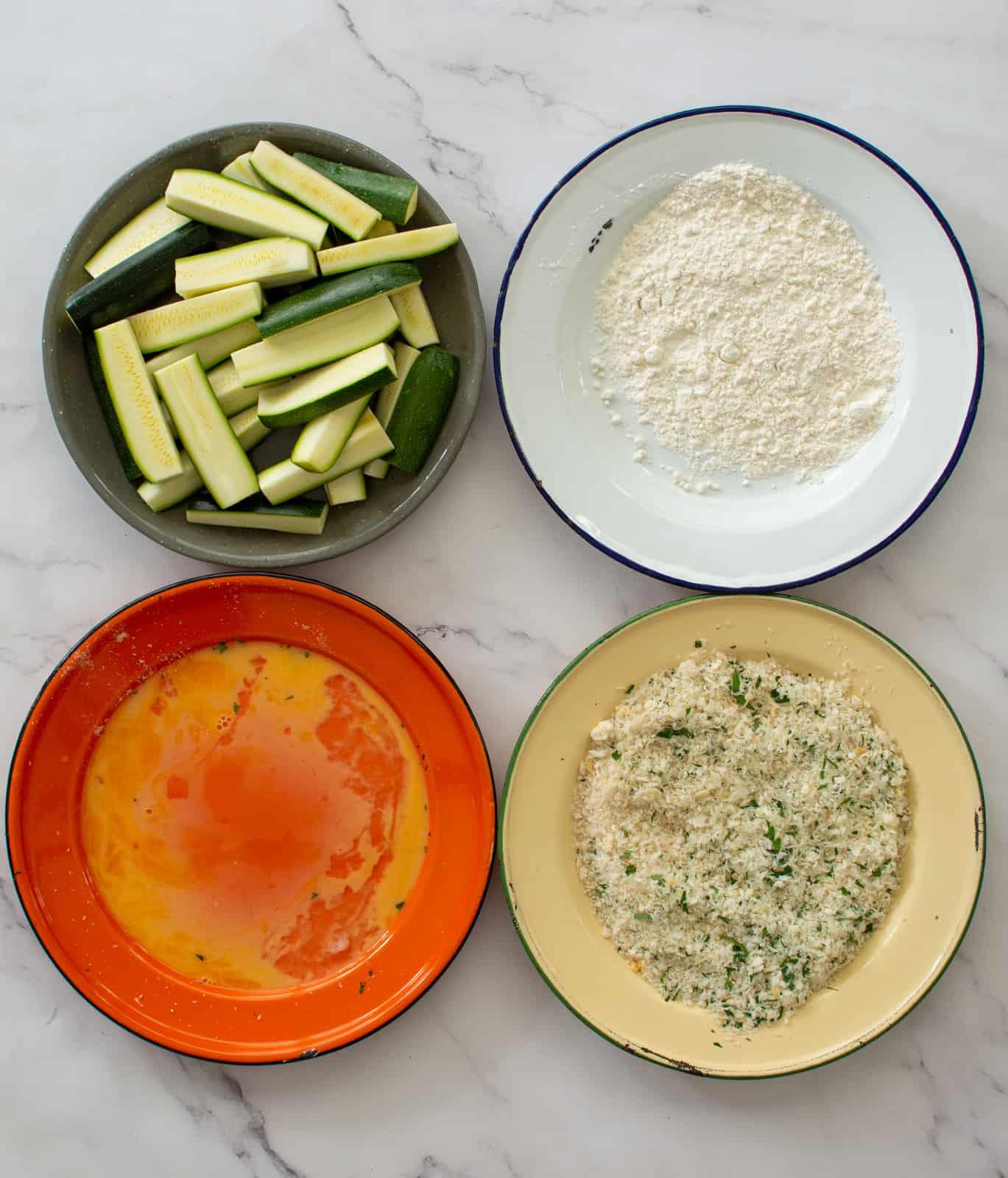 4 plates - zucchini, flour, eggs and breadcrumbs