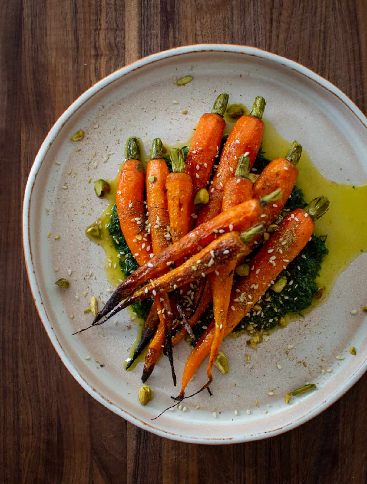 carrots, carrot top pesto and dukkah on a plate