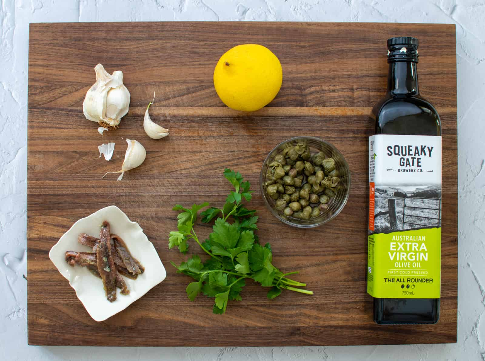 anchovy salsa ingredients on a chopping board