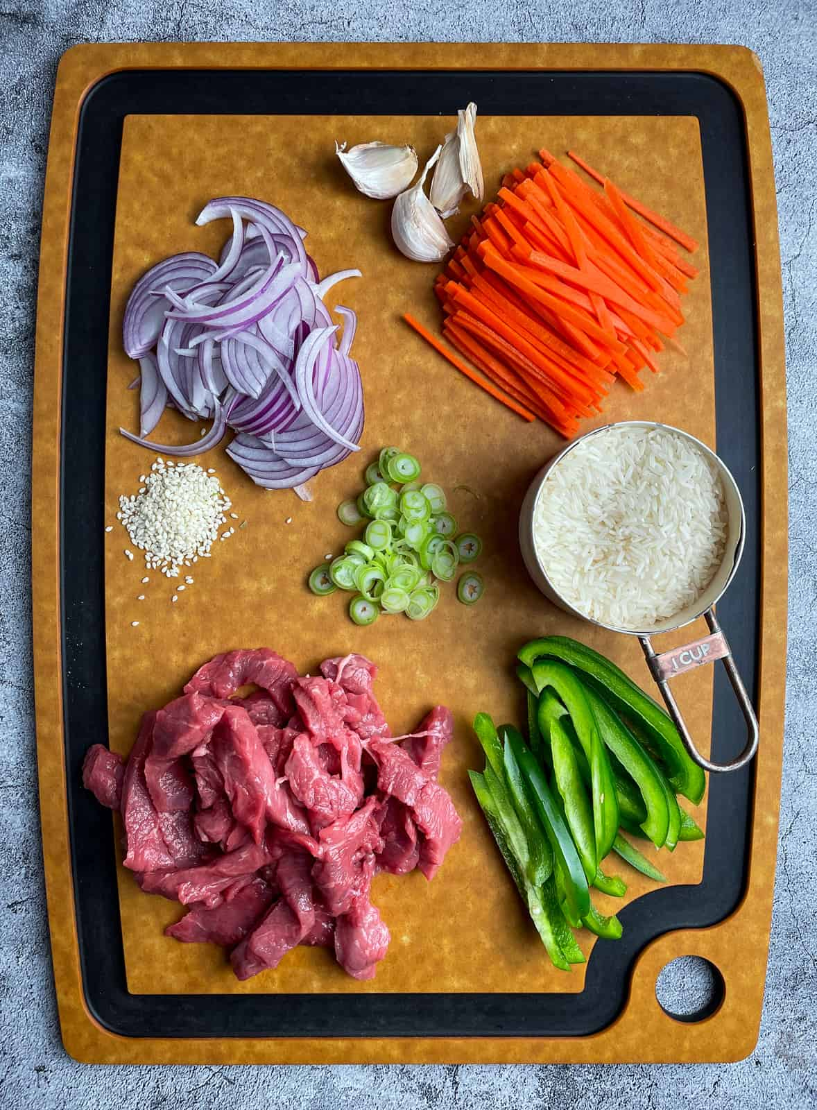 Chopped vegetables and beef on a chopping board