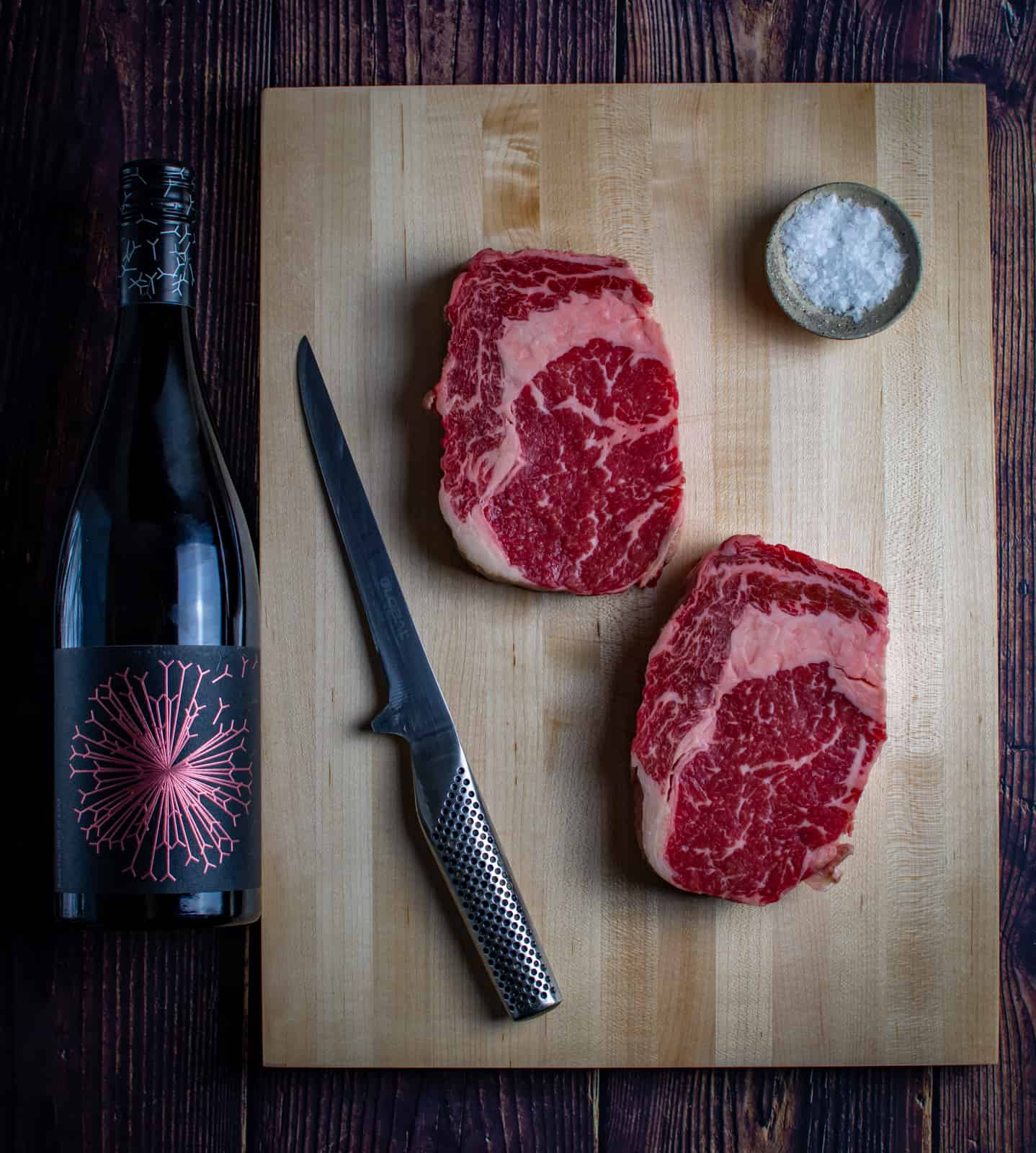 steak, red wine and a chef knife