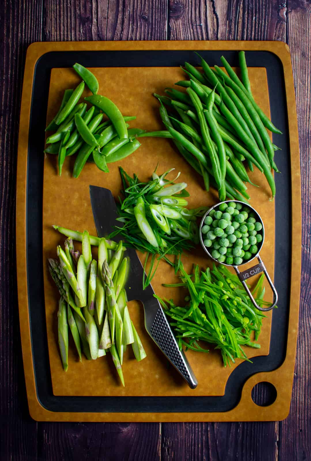 mixed green vegetables on chopping board
