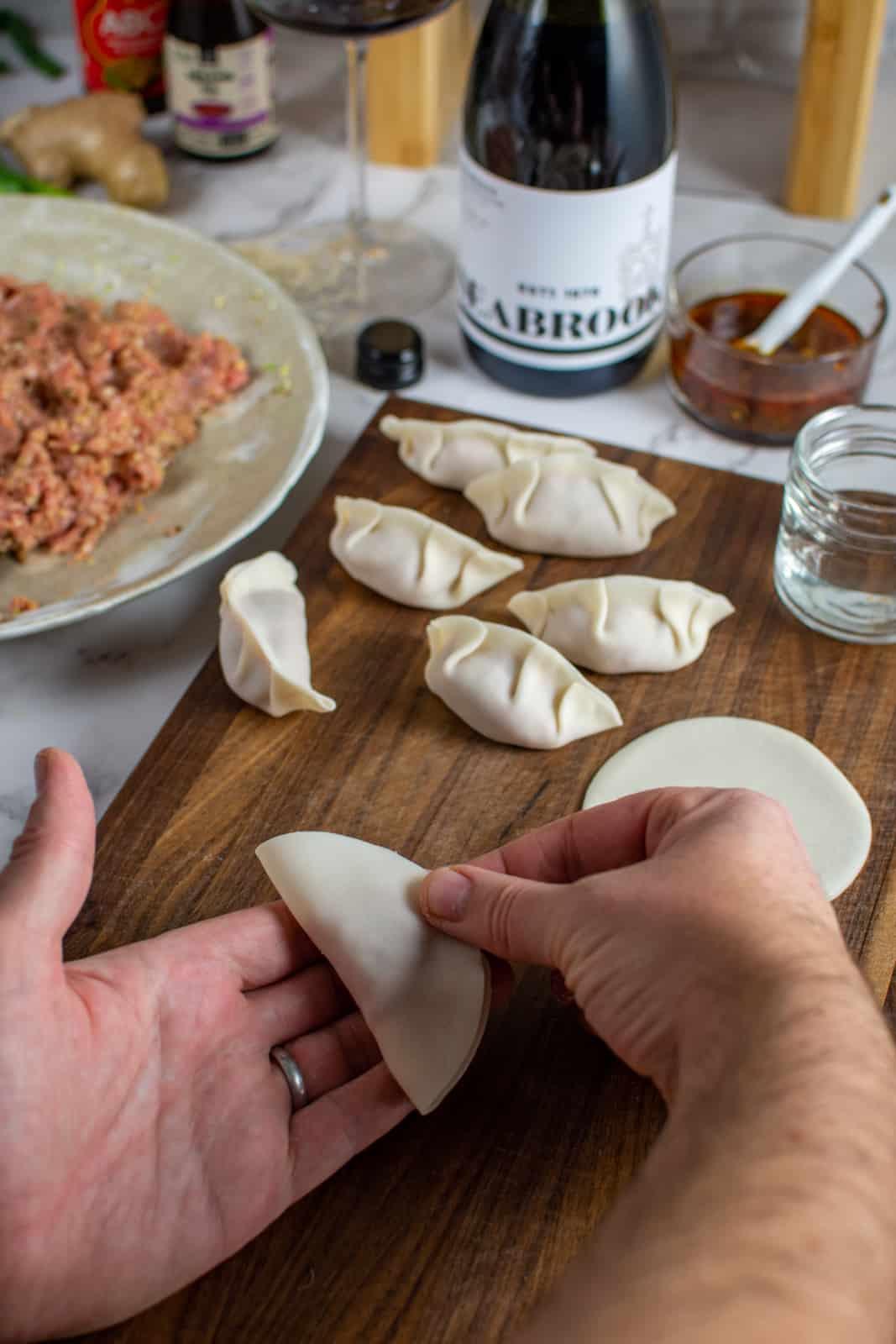 A dumpling wrapper being folded