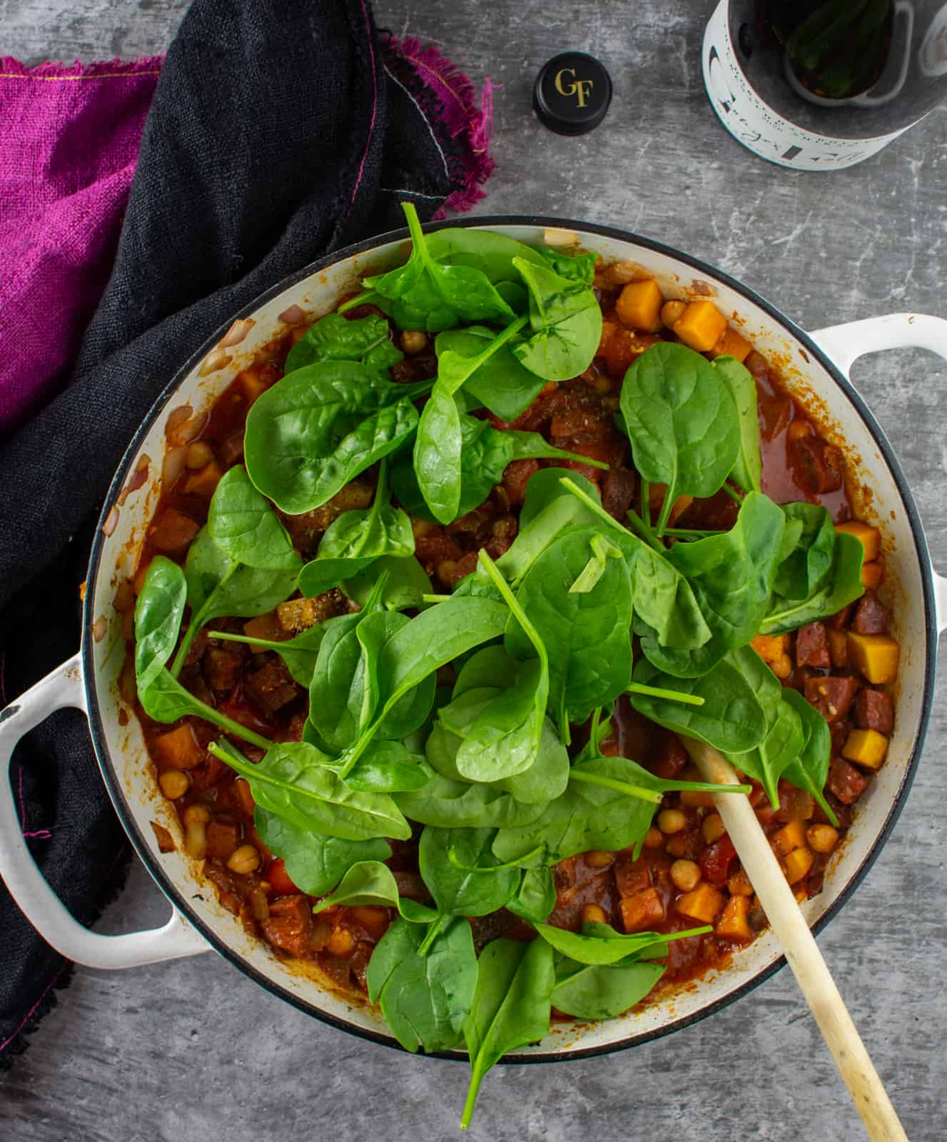 spinach and chickpea stew in a casserole dish