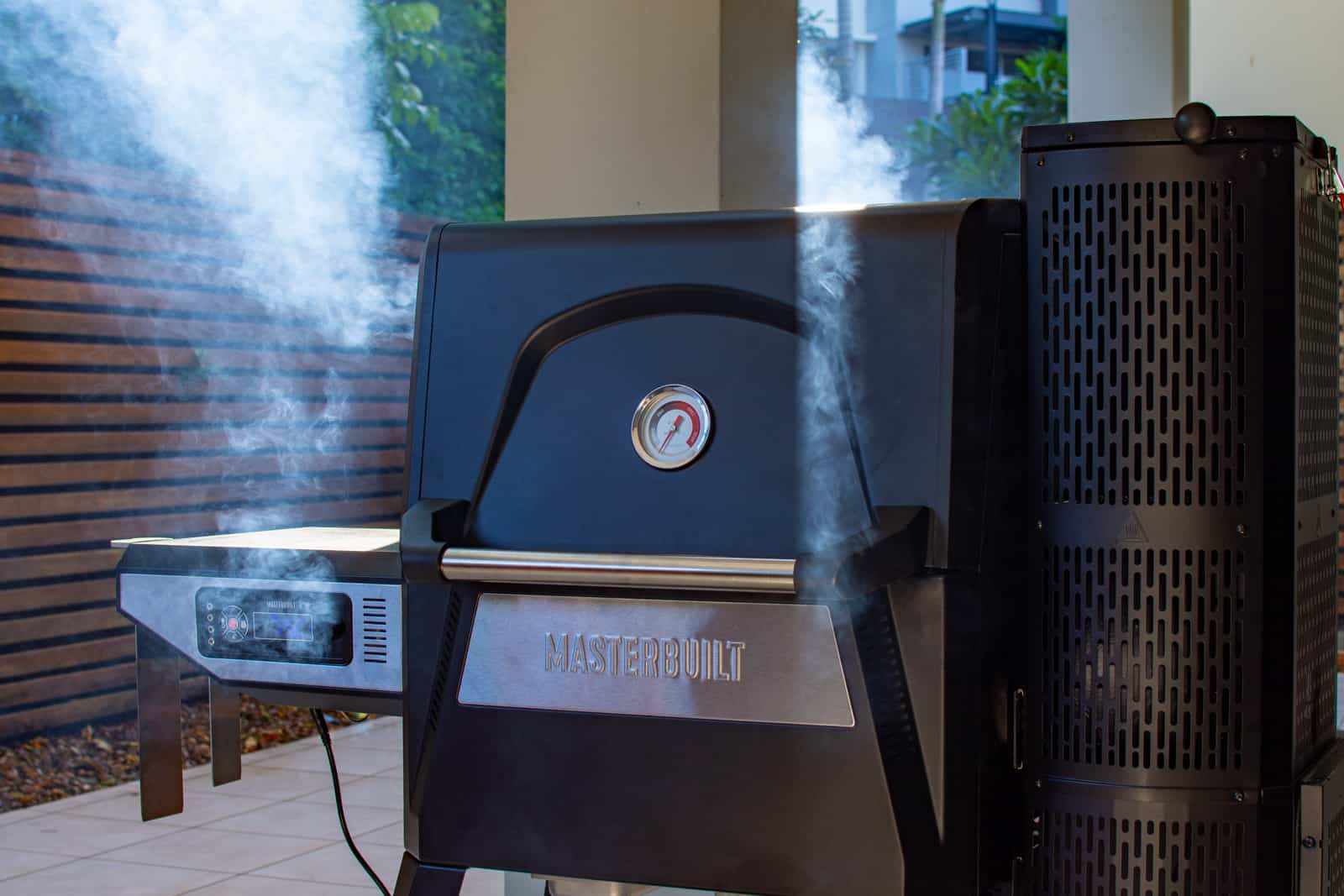 masterbuilt BBQ with smoked coming from it