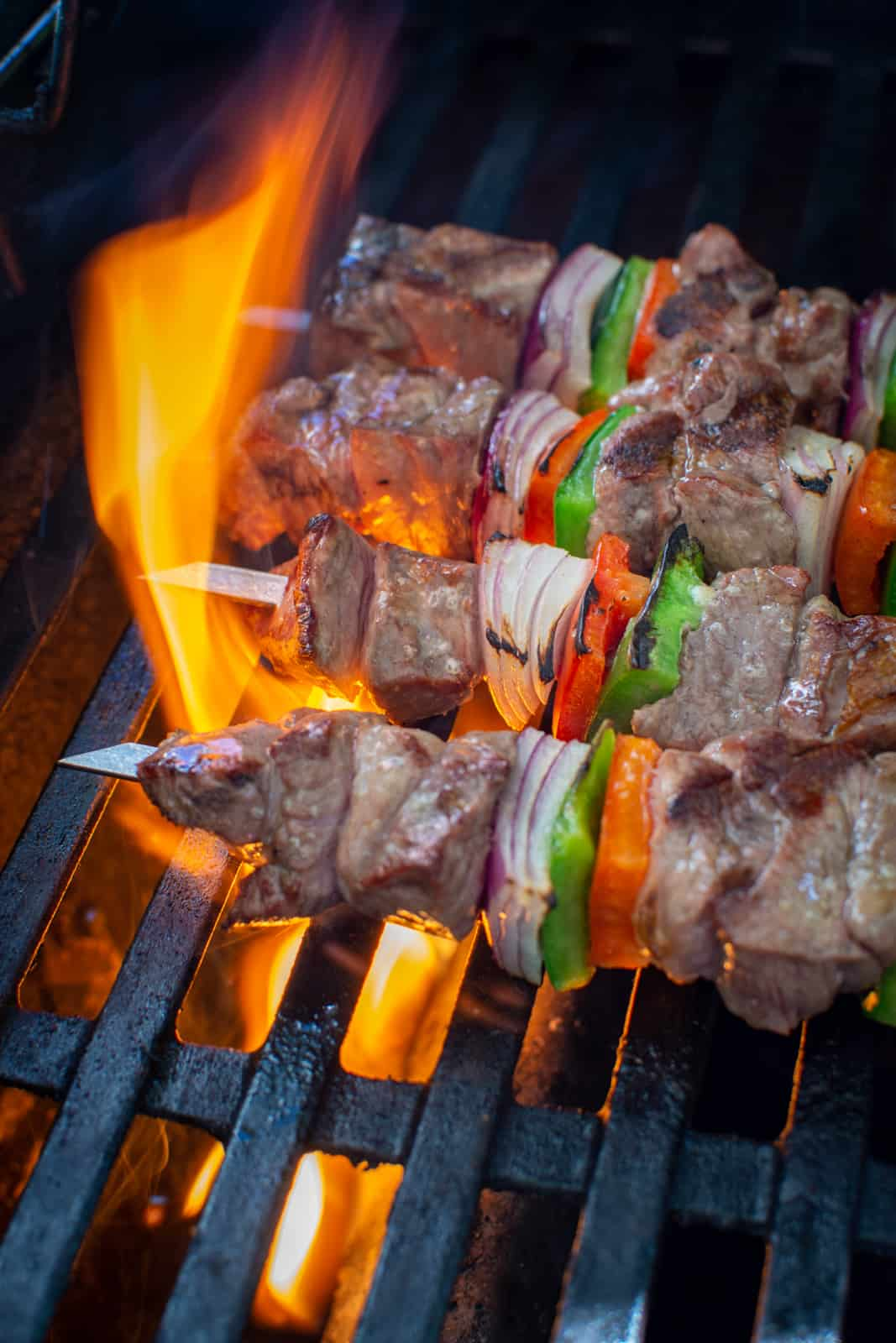 lamb kebabs being grilled on BBQ